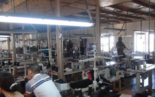 В Одеській області викрили підпільне виробництва підробленої продукції відомих світових брендів